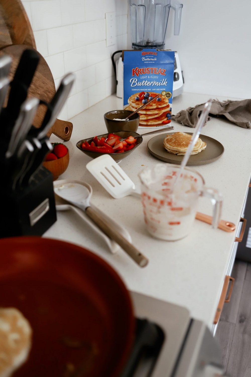 Easy Buttermilk Pancakes with Gingered Strawberries and Cream, a recipe featured by top FL lifestyle blogger, Tabitha Blue of Fresh Mommy Blog.