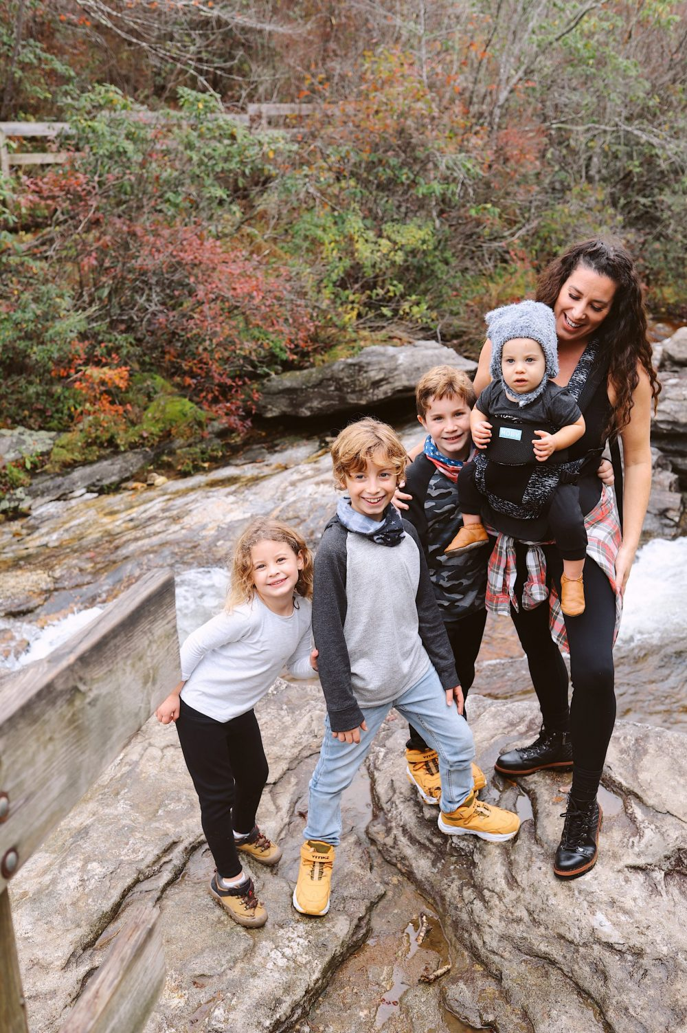 Road Trip Packing Tips by popular Florida travel blog, Fresh Mommy Blog: image of a mom and her young kids standing next to a waterfall.