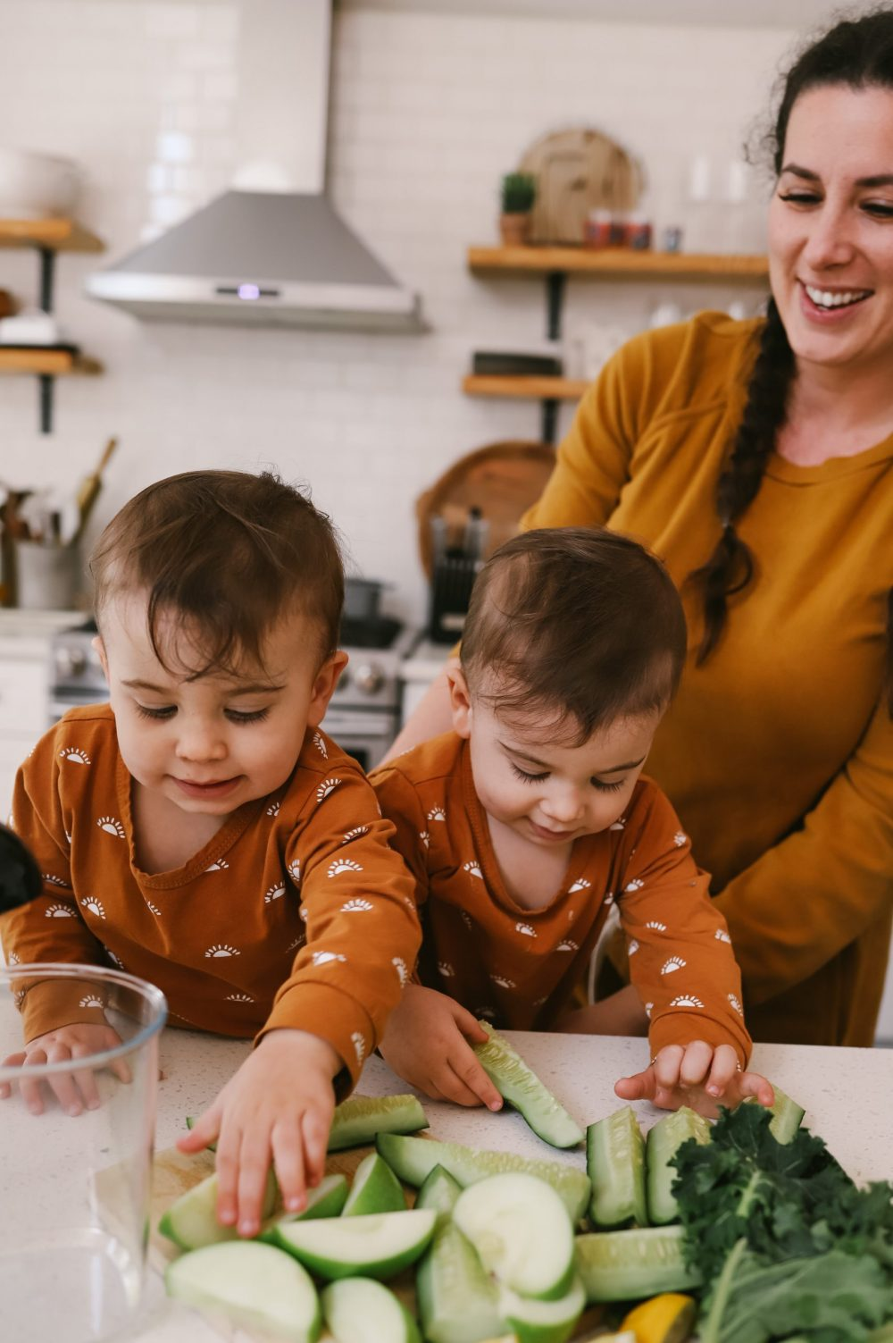 The Best Easy Clean Juicer Review for 2021: We tested easy clean juicers and this is what we found. |Easy Clean Juicer by popular Florida lifestyle blog, Fresh Mommy Blog: image of twin baby boys eating cucumbers.