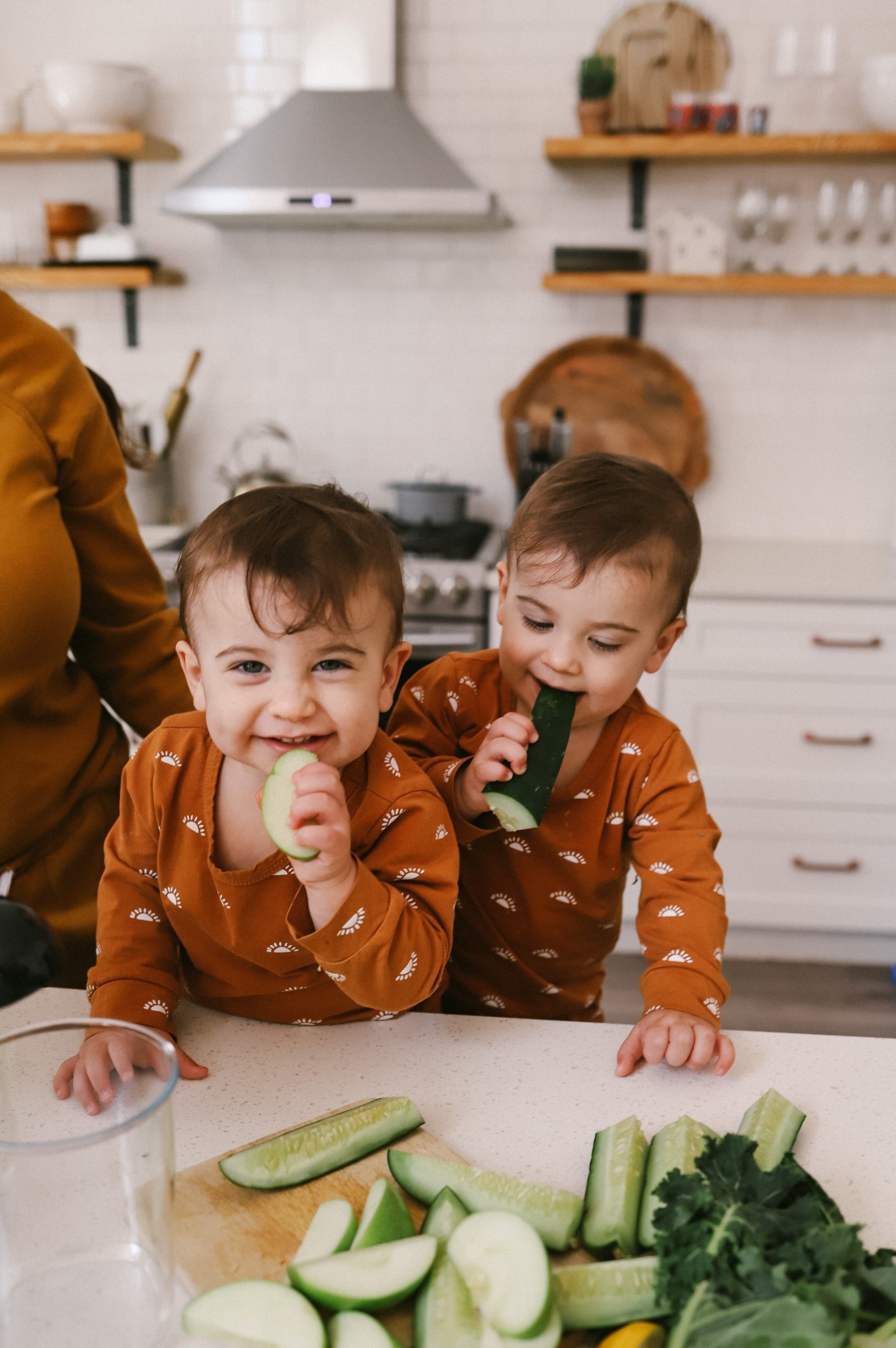 We tested the best easy clean juicers and this is what we found. |Easy Clean Juicer by popular Florida lifestyle blog, Fresh Mommy Blog: image of twin baby boys eating some cucumber spears.