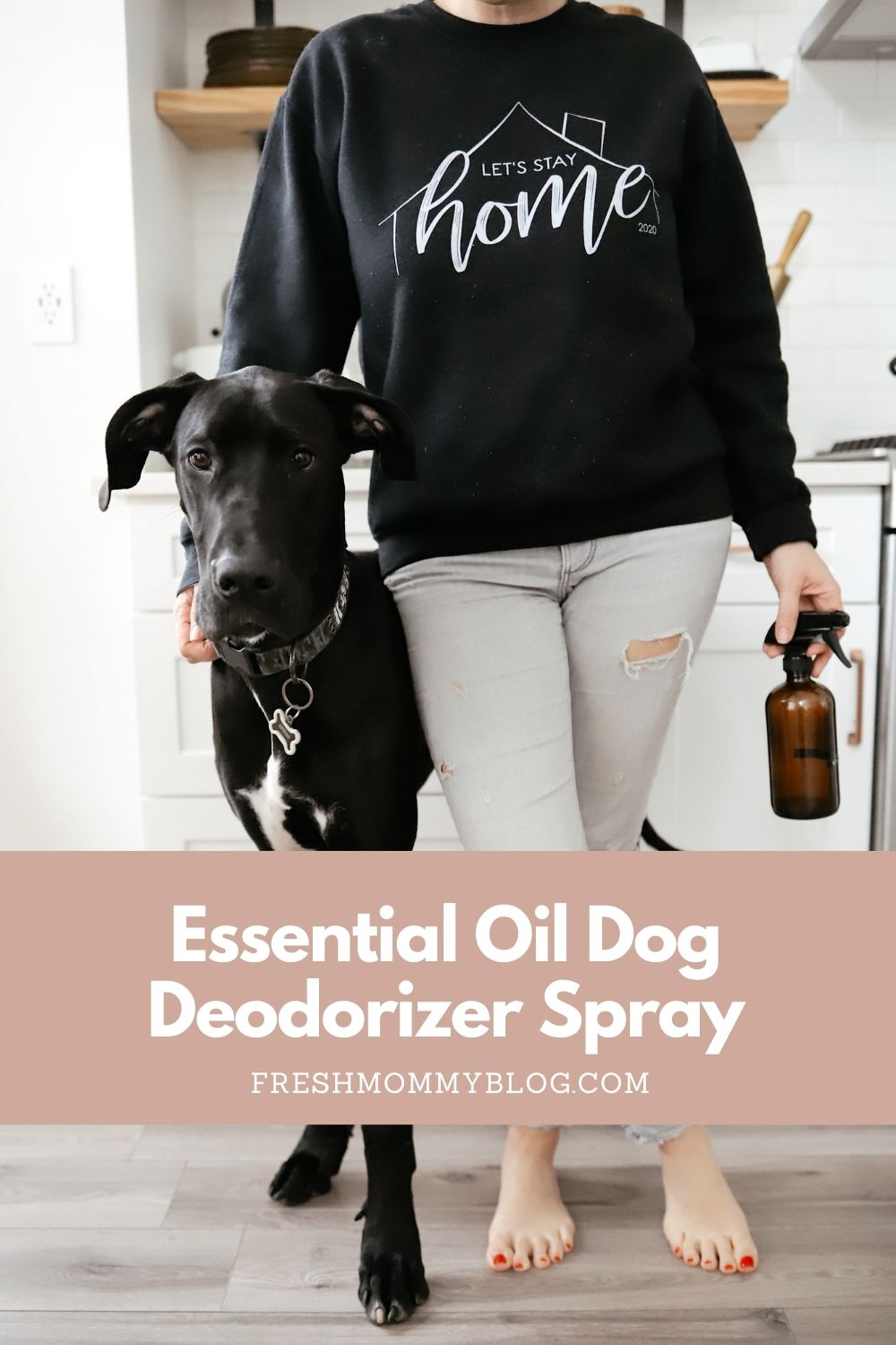 Essential Oils Safe for Dog Deodorizer Spray | Dog Deodorizer Spray by popular Florida lifestyle blog, Fresh Mommy Blog: Pinterest image of a woman wearing a Let's Stay Home sweatshirt and standing next to her black Great Dane dog.