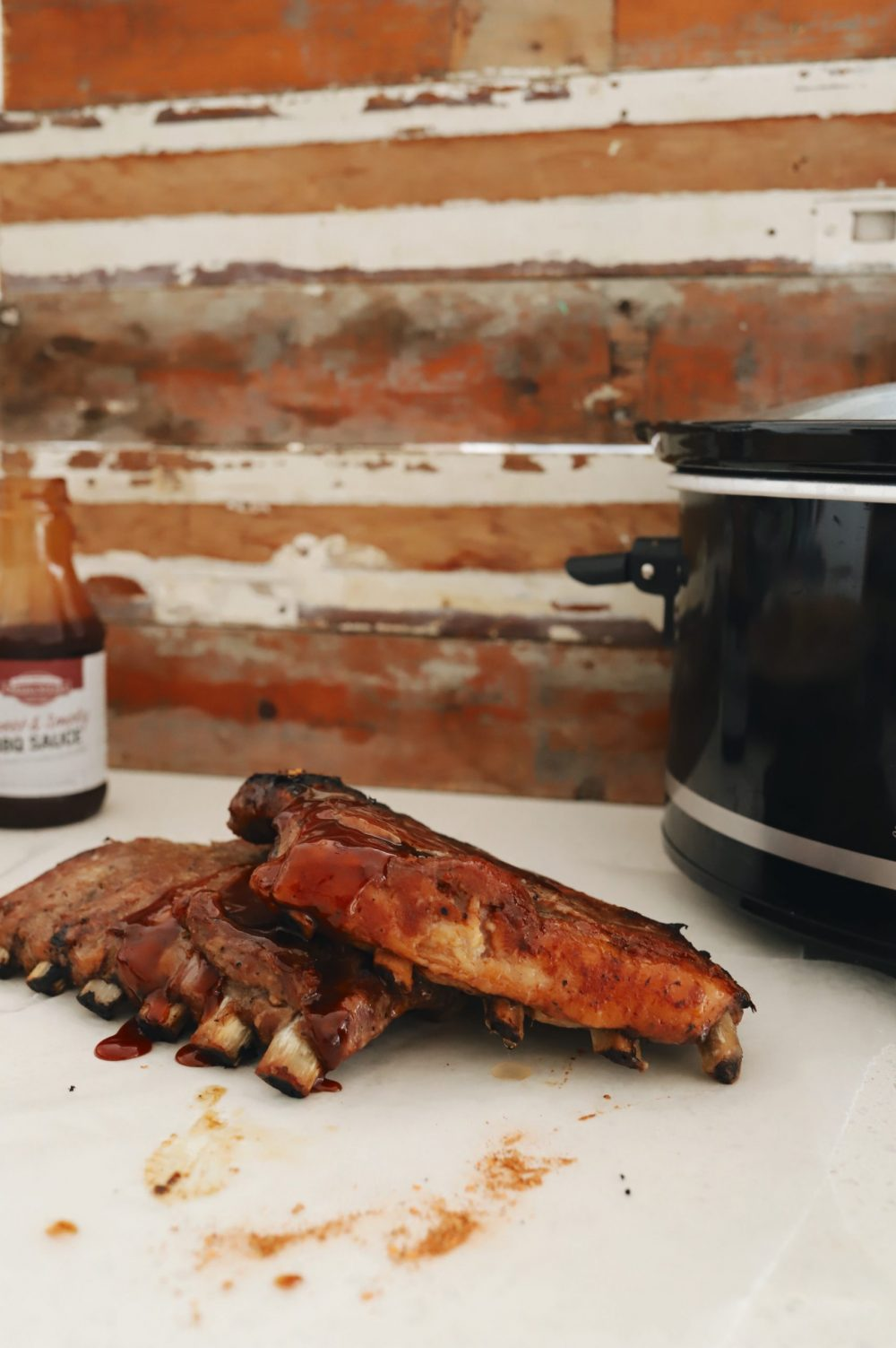 The Easiest Slow Cooker Ribs Recipe You Will Ever Make for tender fall off the bone ribs! |Slow Cooker Ribs by popular Florida lifestyle blog, Fresh Mommy Blog: image of slow cooker ribs.