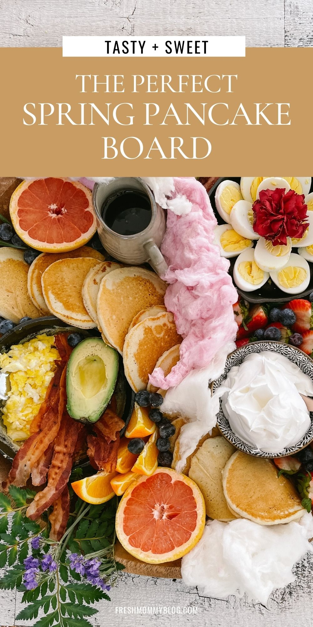 How to Make a Pancake Board That Looks as Delicious as It Tastes. The best Spring Breakfast Board |Pancake Board by popular Florida lifestyle blog, Fresh Mommy Blog: Pinterest image of a pancake board with pancakes, grapefruit, blueberries, avocado, deviled eggs, bacon, scrambled eggs, and strawberries.