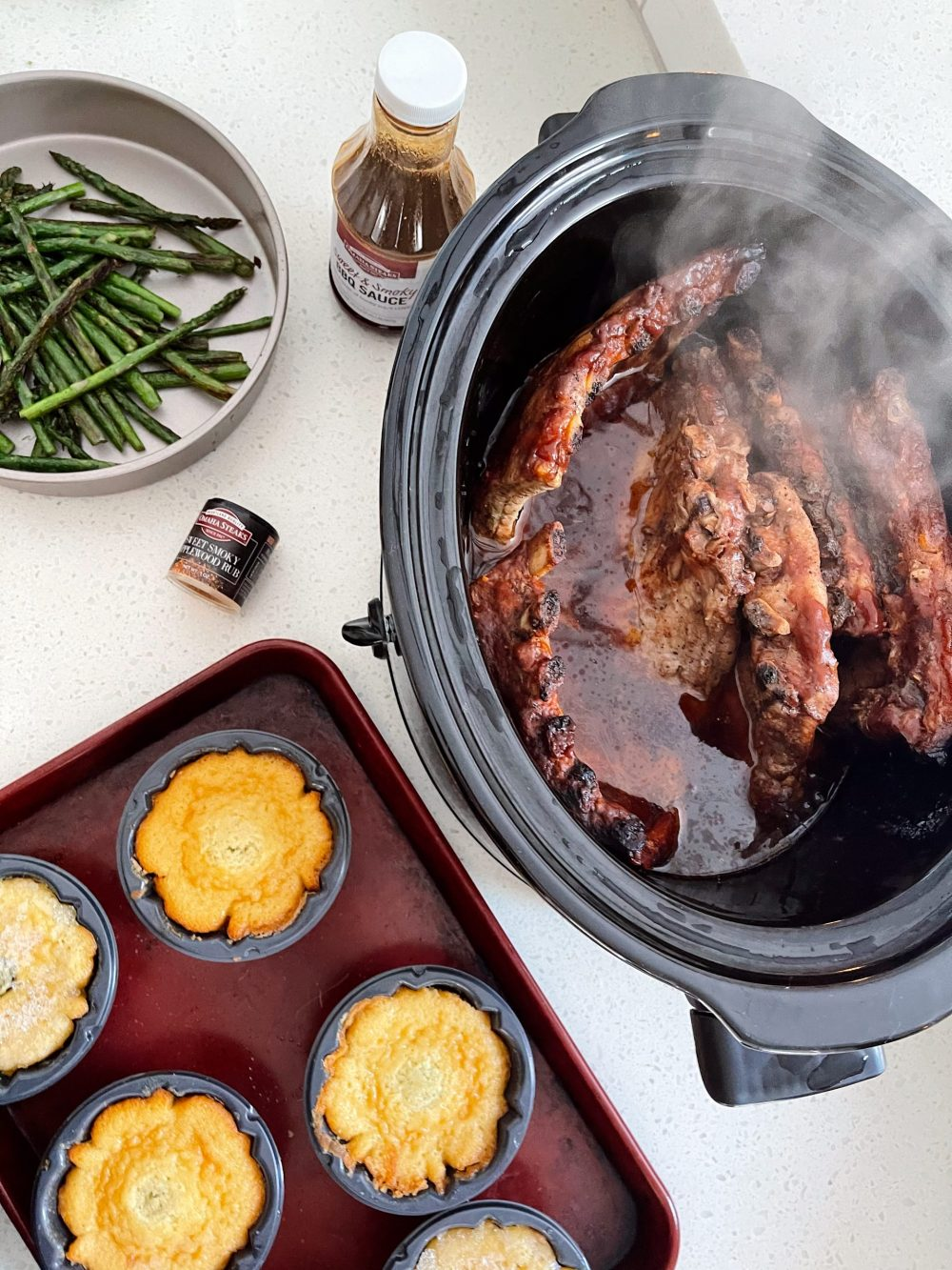 Omaha Steaks Meals featured by top FL lifestyle blogger, Tabitha Blue of Fresh Mommy Blog. - Slow Cooker BBQ Ribs | Omaha Steaks Meals by popular Florida lifestyle blog, Fresh Mommy Blog: image of slow cooker ribs next to some cornbread muffins.